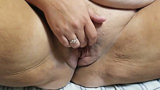 Wife fingers her clit while husband fingers and fists her pussy to orgasm