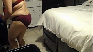 unaware wife getting dressed red bra and panty