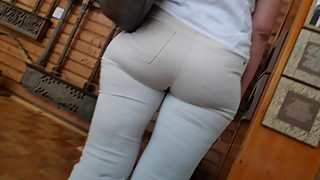 Juicy ass milfs in white tight pants
