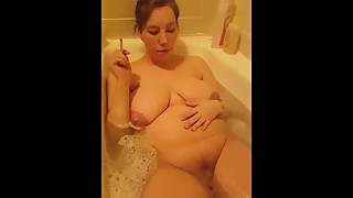 Big Boob wife smoking cigarette in tub with nice pussy up close