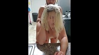Sexy wife gets fucked in the kitchen