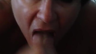 Mature big titted wife sucking out cum