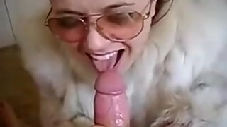 Freaky wife with glasses sucking in fur