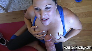 Cute freckled wife Kelly gives a blowjob on her yoga mat