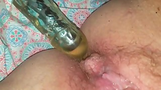 Wife dildos her ass and squirts