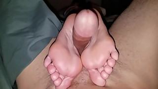 Wife treats me to a footjob