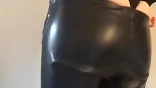 my wife wearing her leather pants before going out